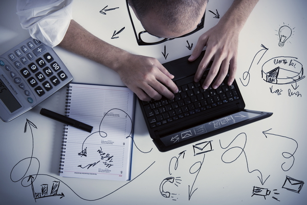 Multitasking Businessman At Work